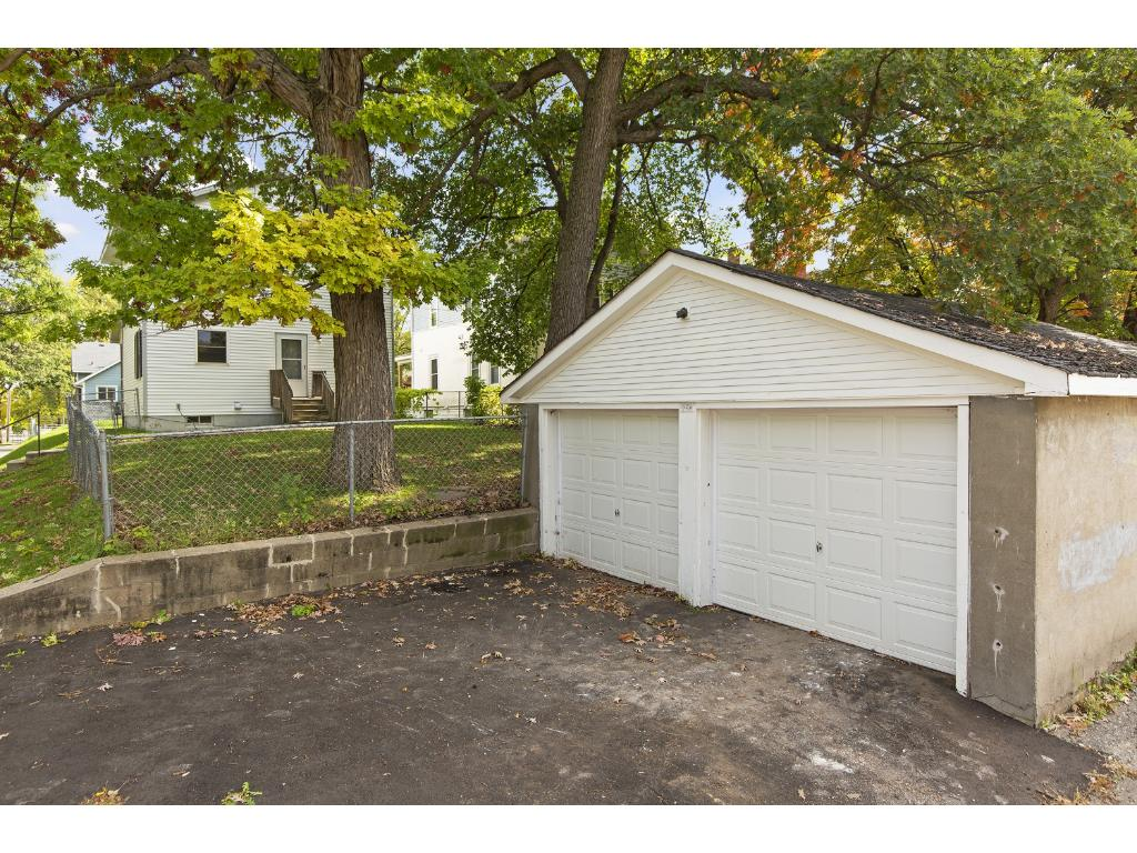Great 2 car garage with newer garage doors and newly blacktopped driveway