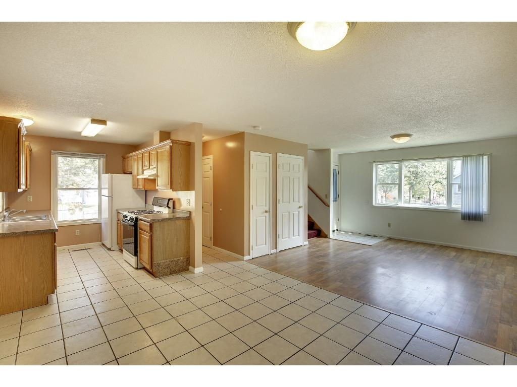 Large dining area adjacent to kitchen and living room