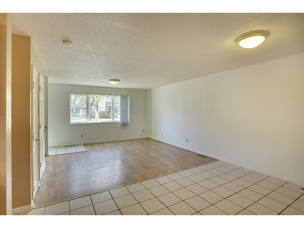 Kitchen and dining areas feature tiled floors and living area has laminate flooring.