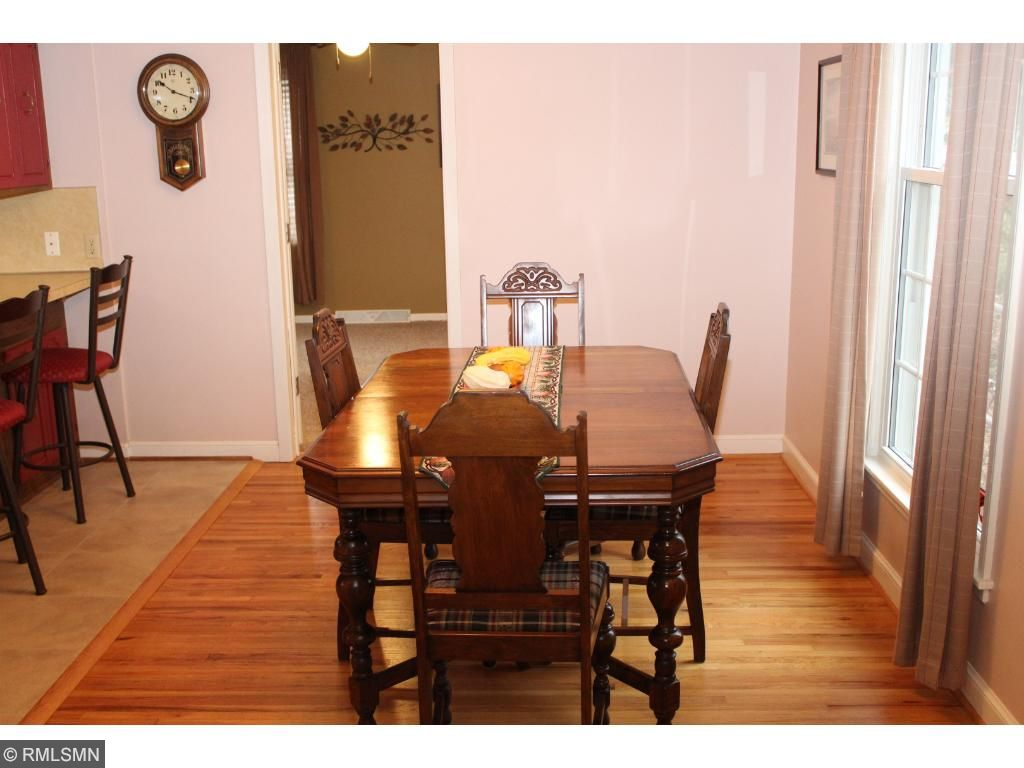 Dining area just off kitchen, beautiful original wood floors!