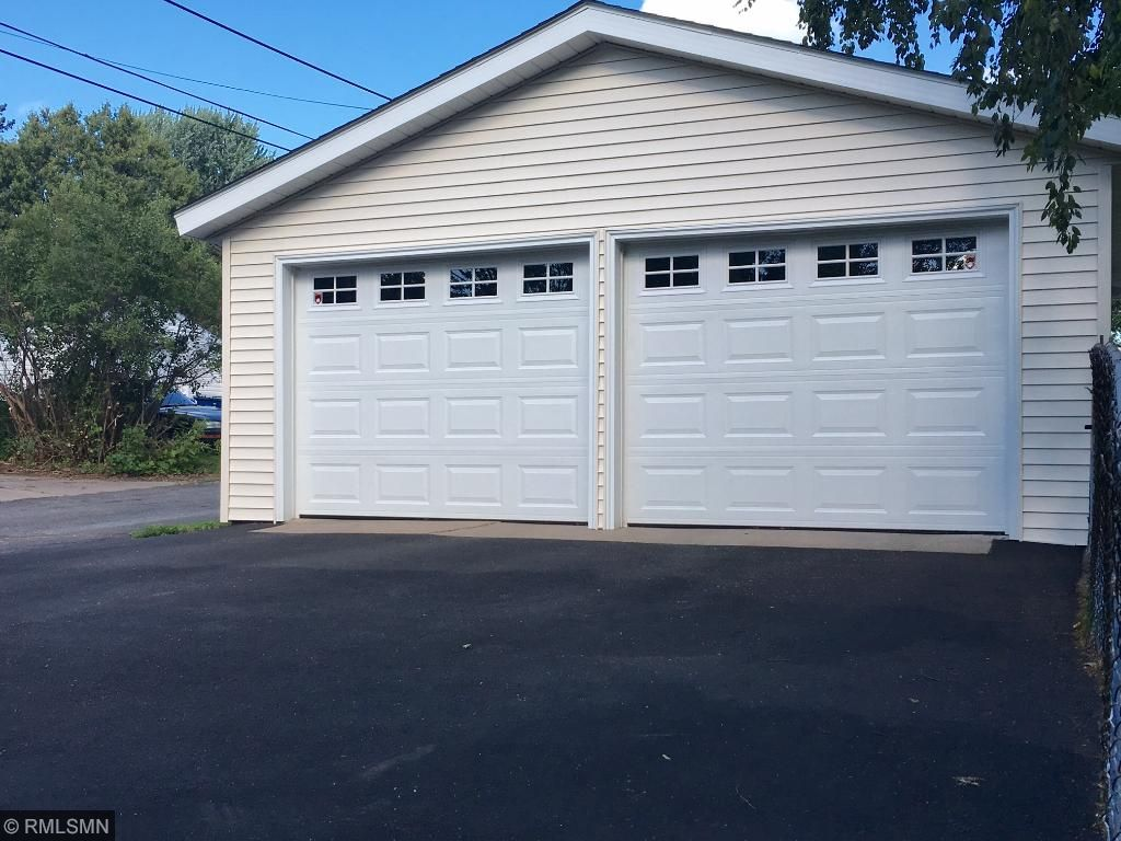 Large detached garage with extra parking just off backyard!  Newly sided and new garage doors with openers!