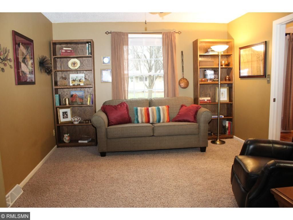 Main level family room with a private bath and lots of closet space - can also be used for a main level bedroom or an office!