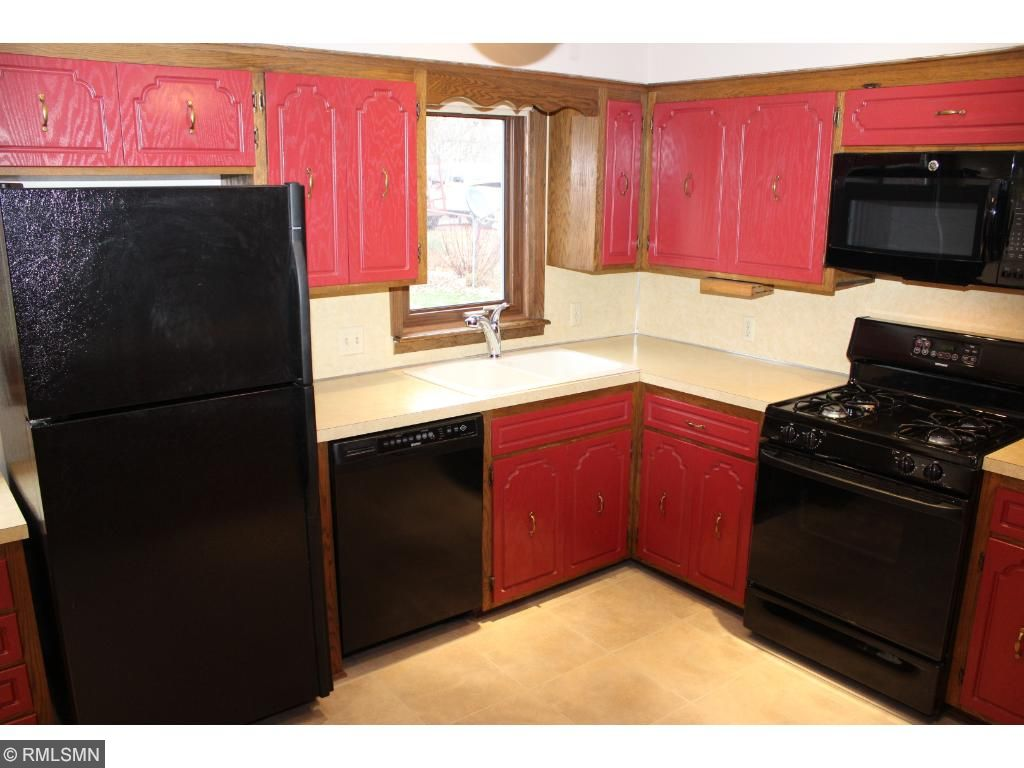 Spacious kitchen overlooks backyard with a convenient service door to patio!