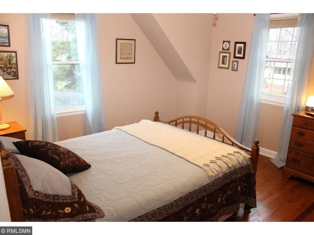 Upper level bedroom with 2 windows, plenty of light open and cheery!