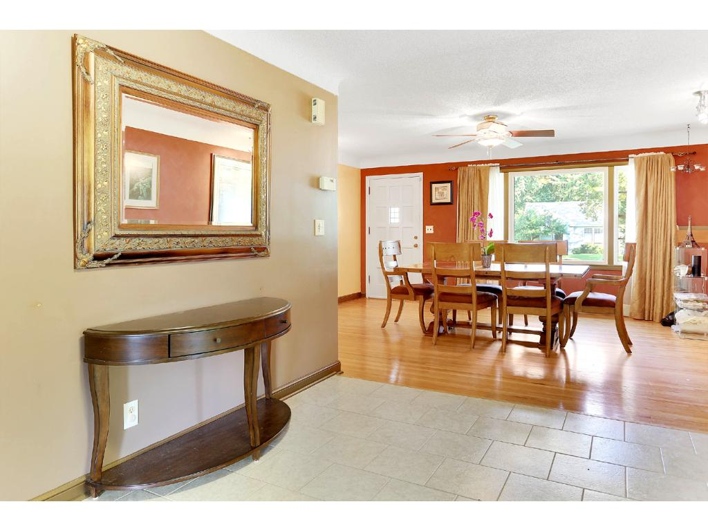 This multipurpose area is perfect if you just want a Formal Dining Room, OR can be used as Living Room, with your Informal Dining Room table and chairs, on Tile Area!