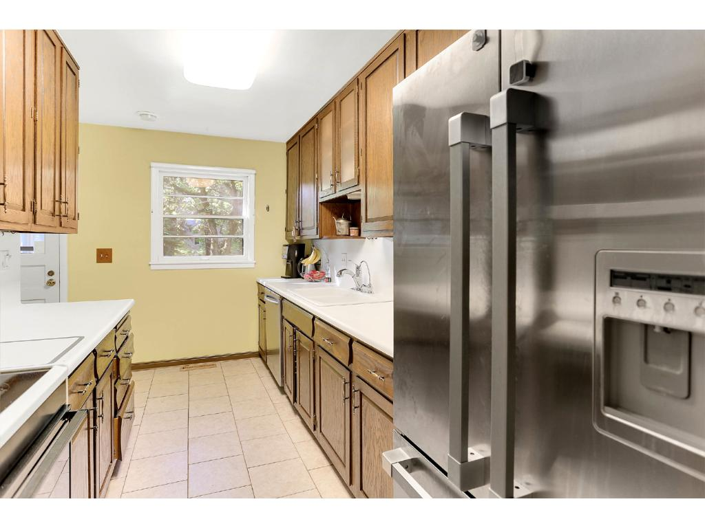 This beautiful Galley Kitchen includes a Kitchen Window and both a Ceiling Vent and Microwave Hood that both vent to the exterior. The kitchen also includes a Large, High-End Fisher and Pakel Stainless Steel Refrigerator!