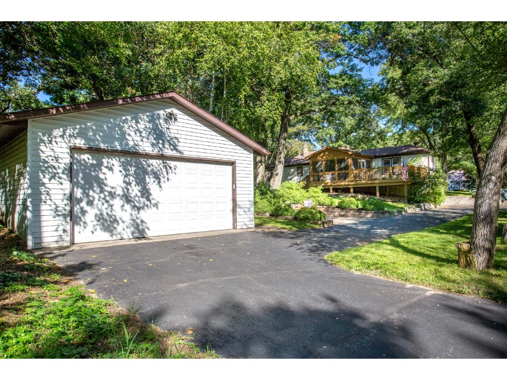 Now this is a garage! This oversized (30x24) 2 car detached garage includes a rare 8 foot high by 18 foot door, with 10 foot ceilings and a side access service door. The perfect spot for your large vehicles, & enough room for a large workbench area!
