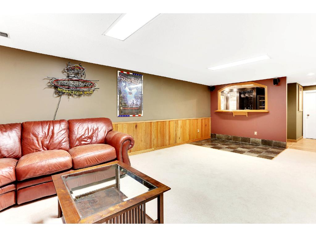 Another view of the spacious Lower Level Family Room 2, with Tiled Bar Area that includes in-floor heating!