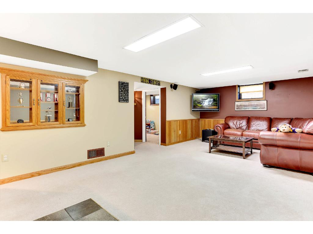 The Lower Level Family Room 2, also includes a Custom Built-In Display Case!