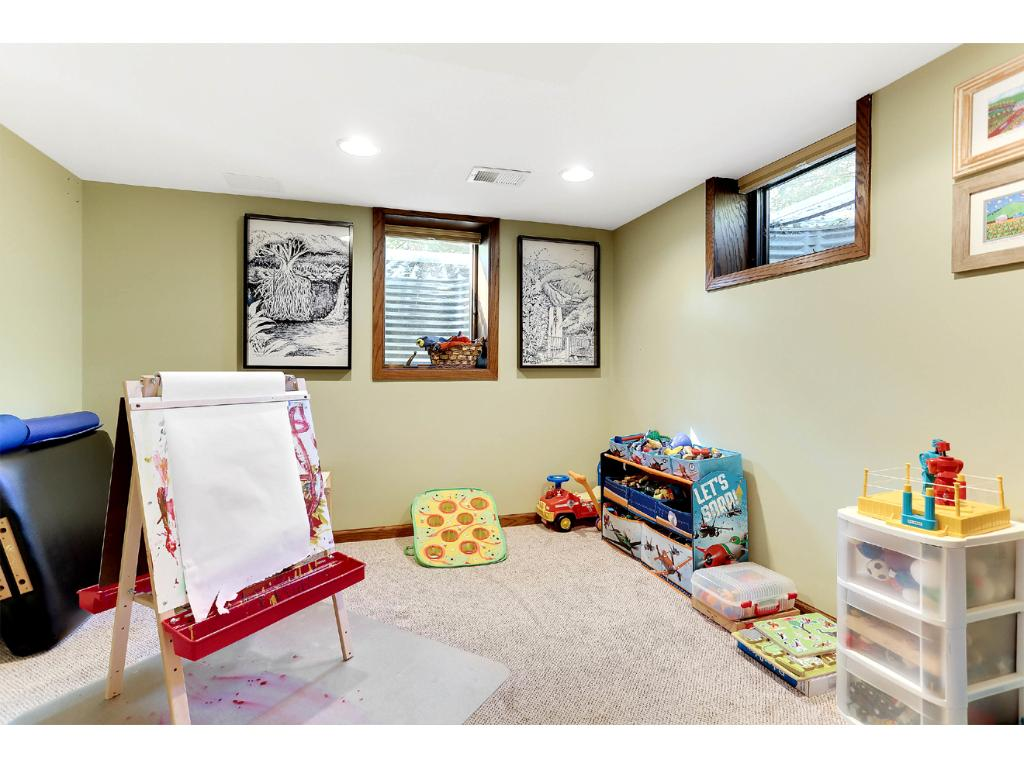 Lower Level Bedroom 4, with Egress Window and Large Closet! Currently being used for the children's play area!