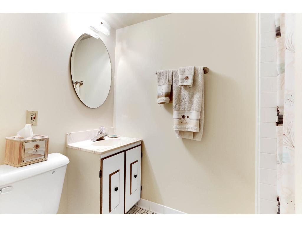 Lower Level Bathroom, with beautifully Tiled Shower and Tile Floors!