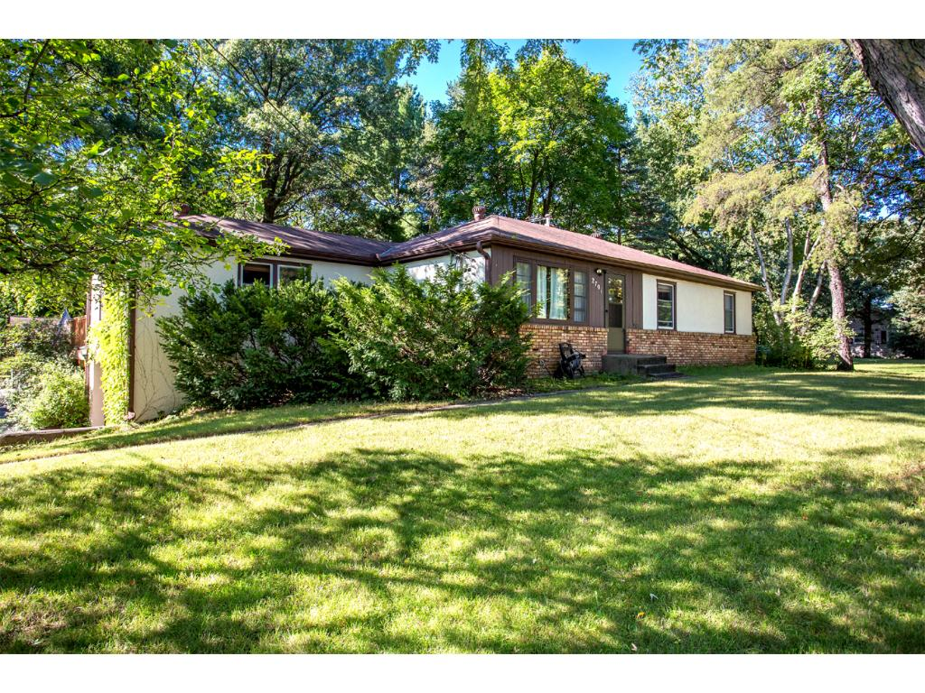 The home has a Charming Brick and Stucco Front Exterior, with Very Spacious Front Yard! The home also includes 200 Amp Service and has a gutter and downspout drainage system!Welcome Home!