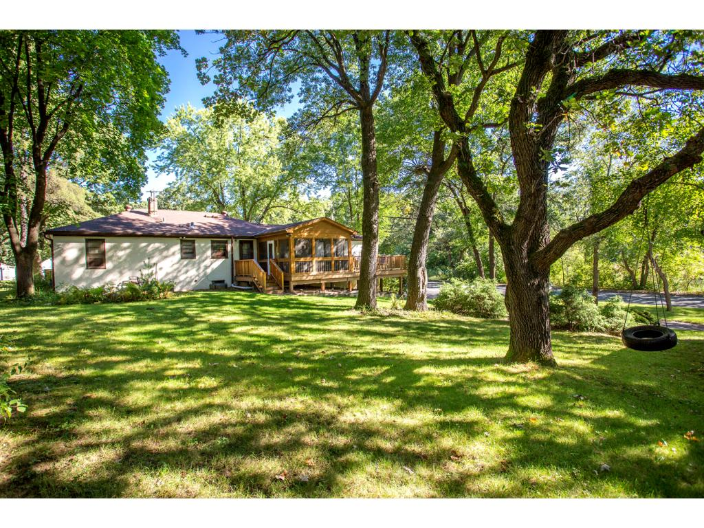 Spacious Backyard full of mature trees and plenty of room for your outdoor recreational or entertainment needs!