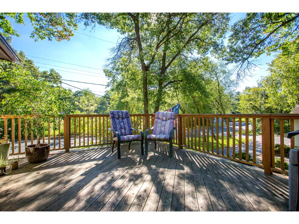 The spacious backyard Cedar Deck is perfectly located, to enjoy the stunning permanent pond and nature views!
