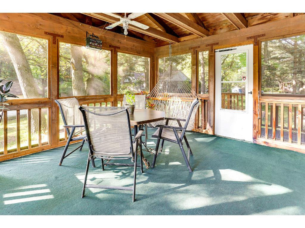 The large Cedar, 3 Season Porch, with ceiling fan, provides the perfect spot to relax and enjoy the fresh air and amazing views!