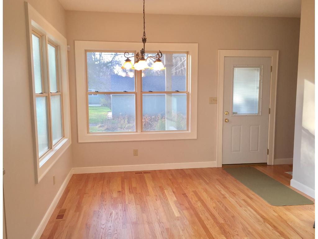 Eat-in kitchen area addition with beautiful hardwood floors and loads of natural light.