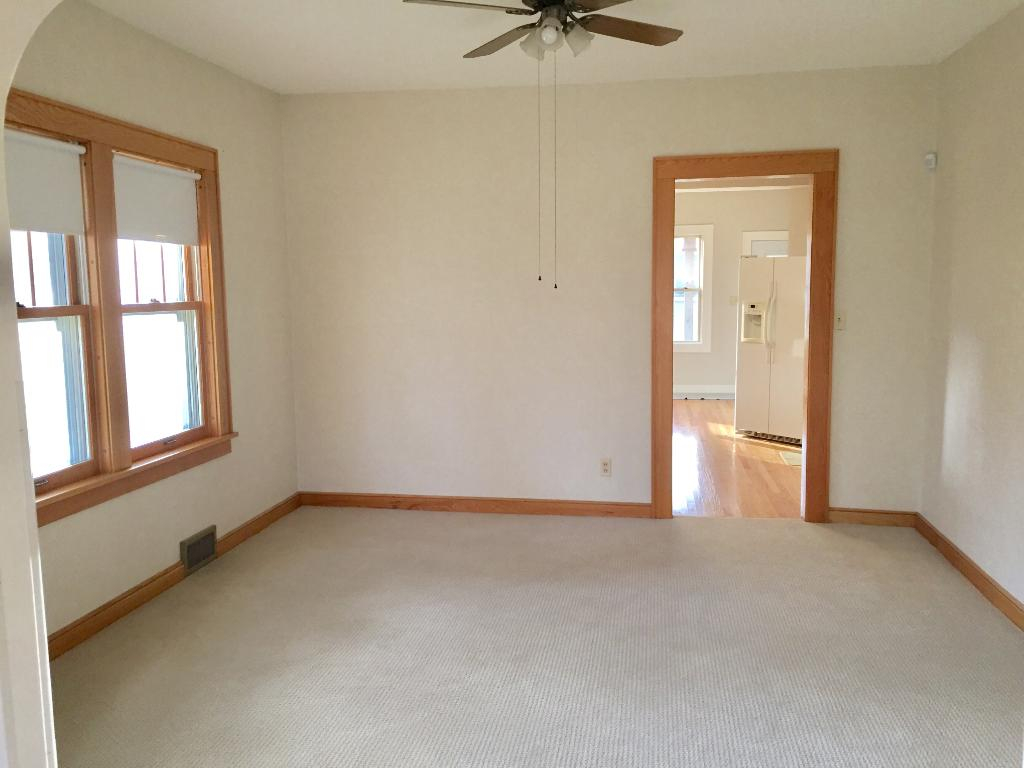 Formal dinging room with new carpet and paint. Plenty of room for formal dining room furniture and hutch.