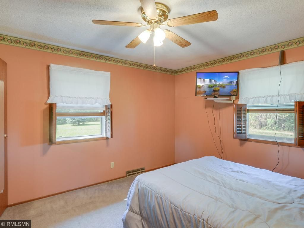Main bedroom has walk-in closet.  All 3 bedrooms have ceiling fans.