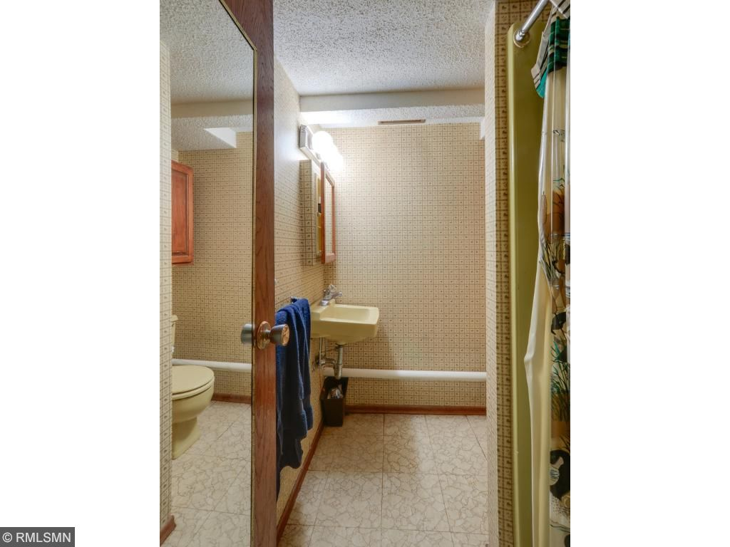 3/4 bath in the basement across from office and den and next to laundry room.