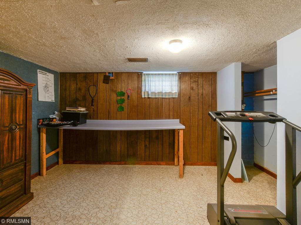Office in the basement.  Similar room adjacent to the right is labeled a den.