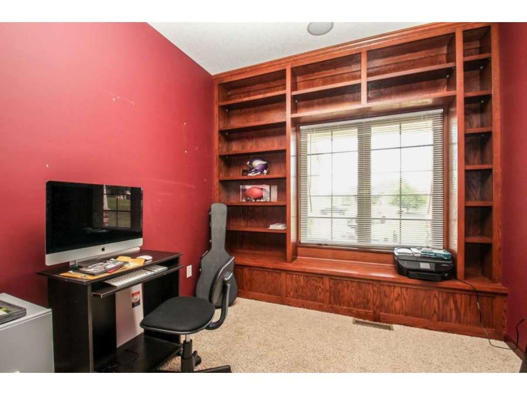 Office with built-in bookshelves and window seat on the main level!