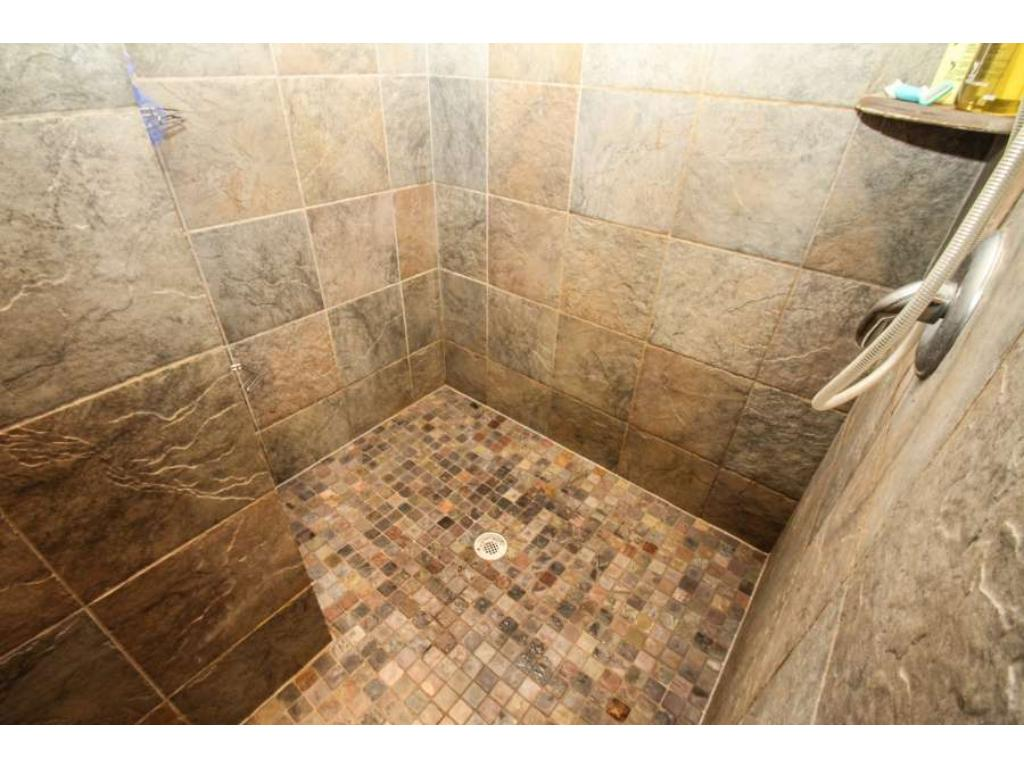 Awesome tile walk-in shower in the owner's suite!