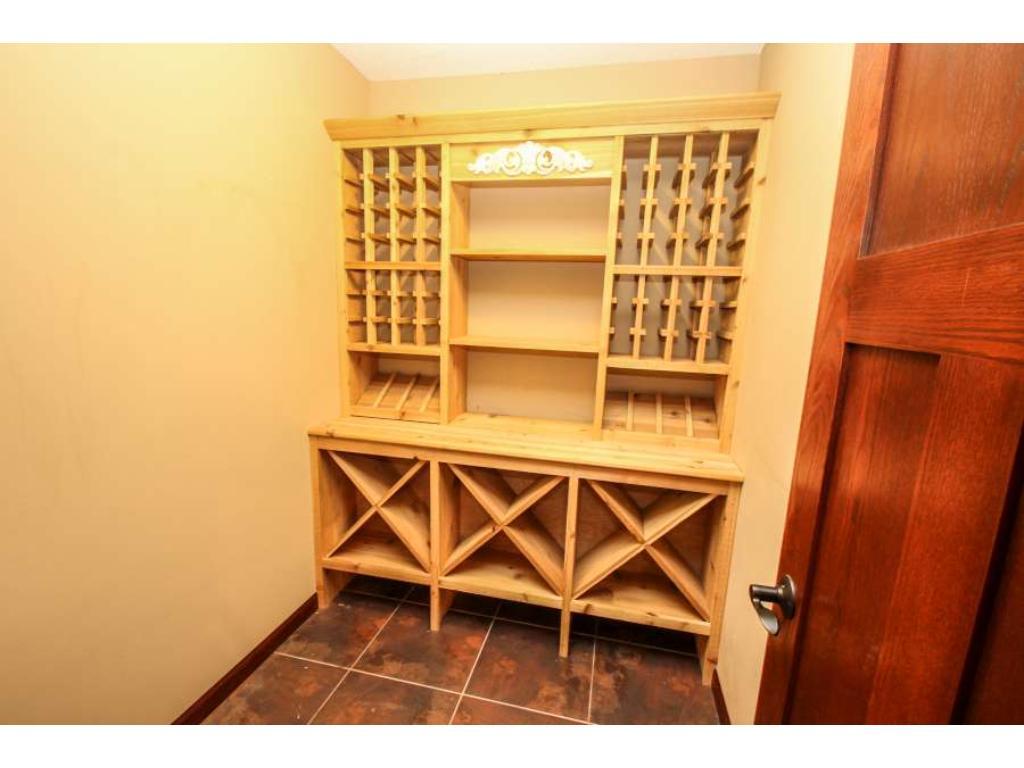 Custom built cabinet in wine cellar!
