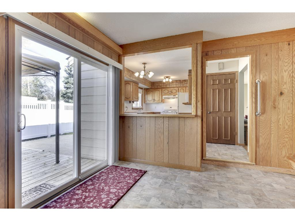 Patio doors from main floor family room to the back deck and maintenance free fencing.  There is also a shed and heated garage.  So many wonderful features here!