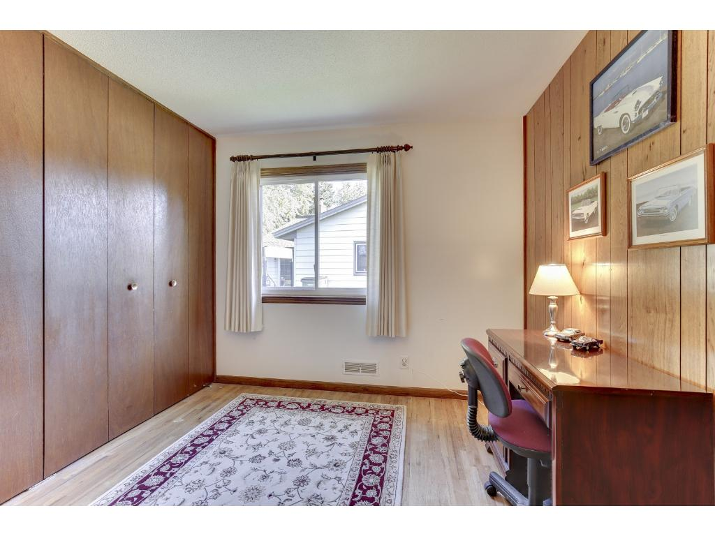 One of three bedrooms on the main level.  All have hardwood floors.