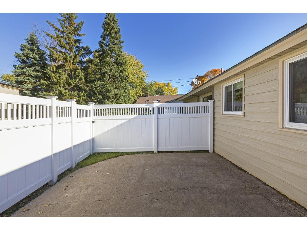Nice deck area between the house and garage.  Private!