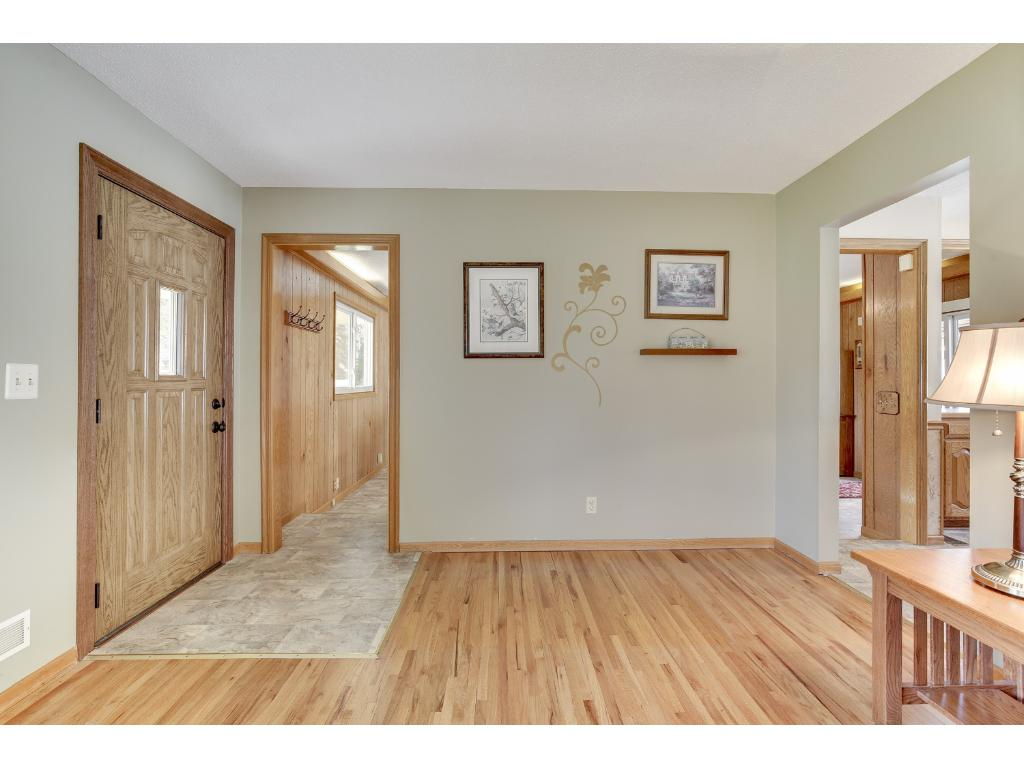 Front entrance and living room with hardwood floors