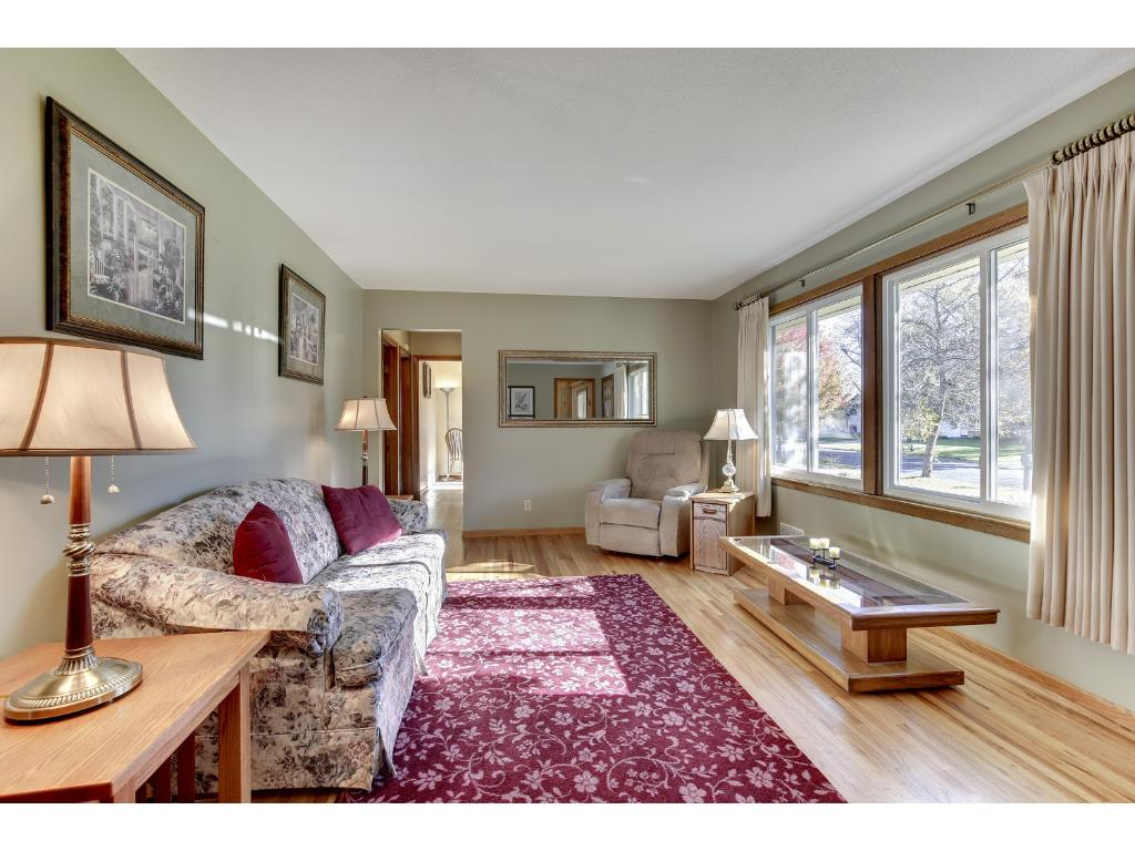 Living Room with large windows and hardwood floors - great natural lighting