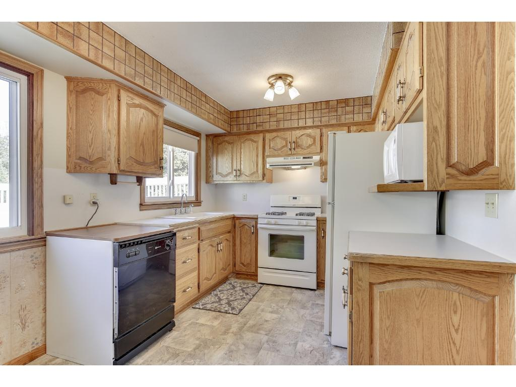 Spacious kitchen with updated cupboards, new flooring in the kitchen and dining area in 2014