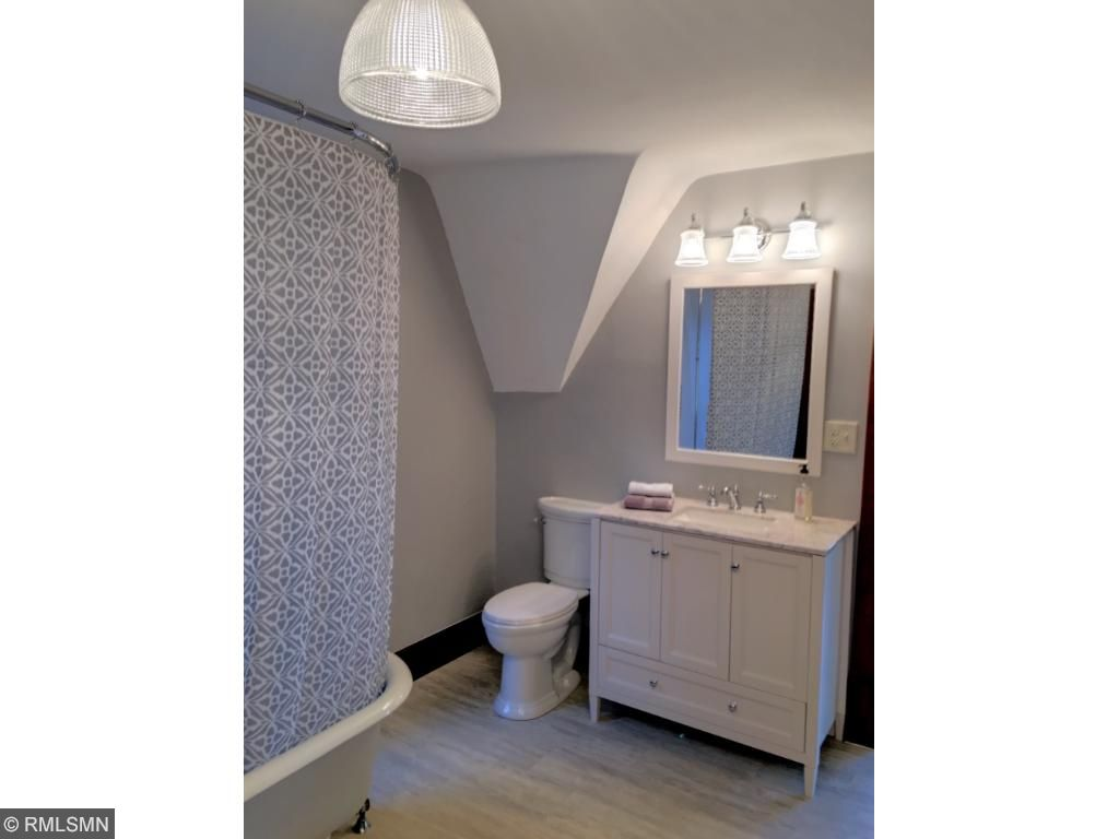 Upper level full bath with clawfoot shower/tub, 2 vanities and linen closet.
