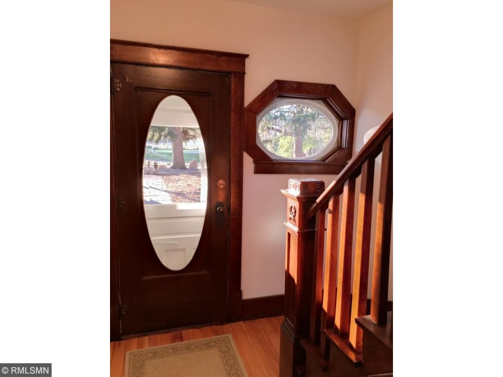 Main entry way with original front door and stair case.