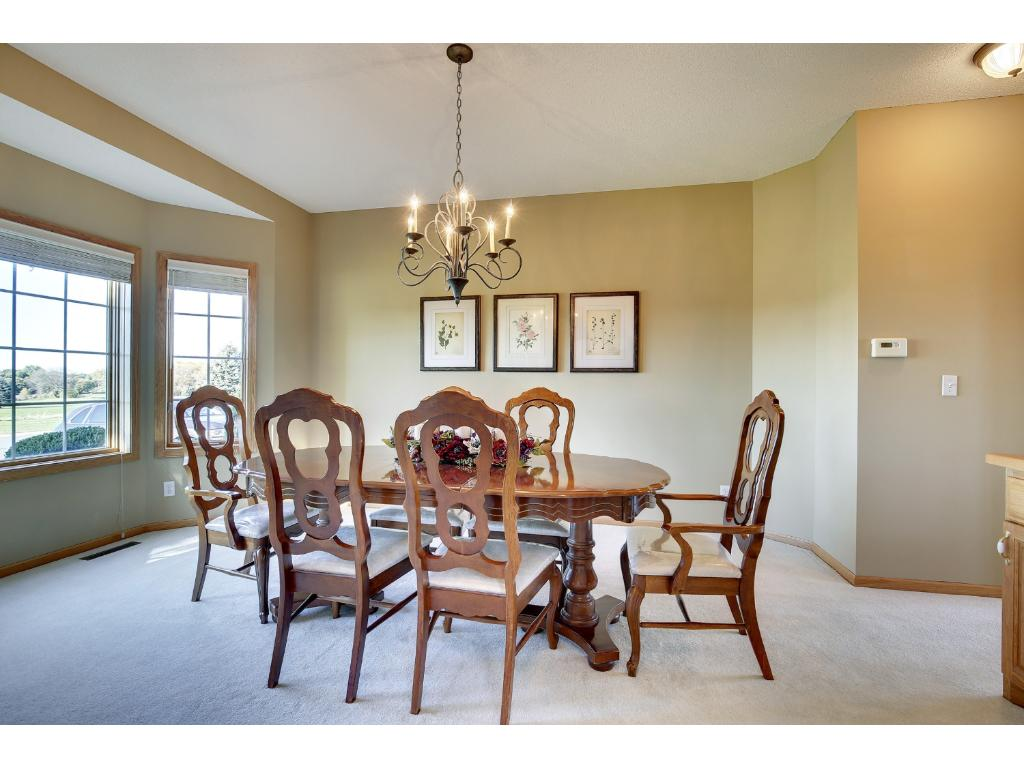 Spacious formal dining room with bay windows for Thanksgiving dinner