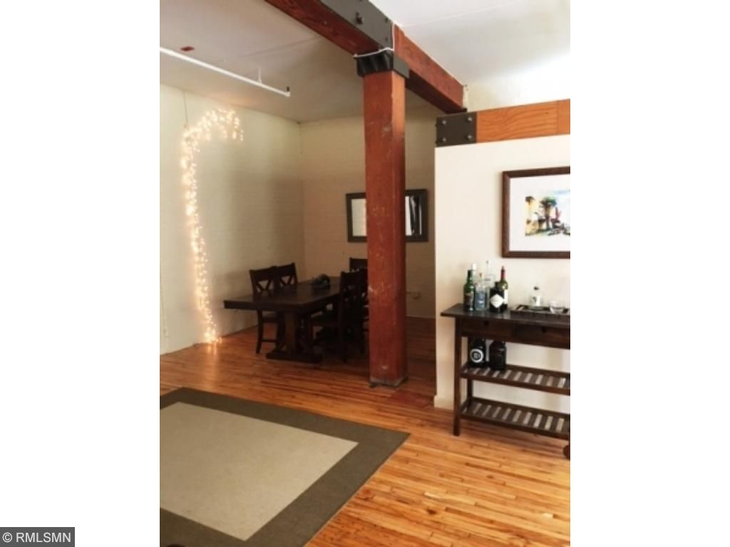 Refinished Hardwood Floors and Natural Beams