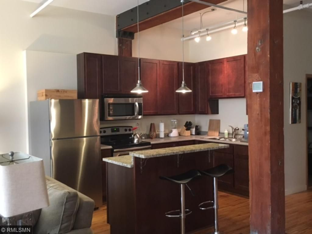 Custom Cabinets, Stainless Steel Appliances, Kitchen Island with Granite Countertop