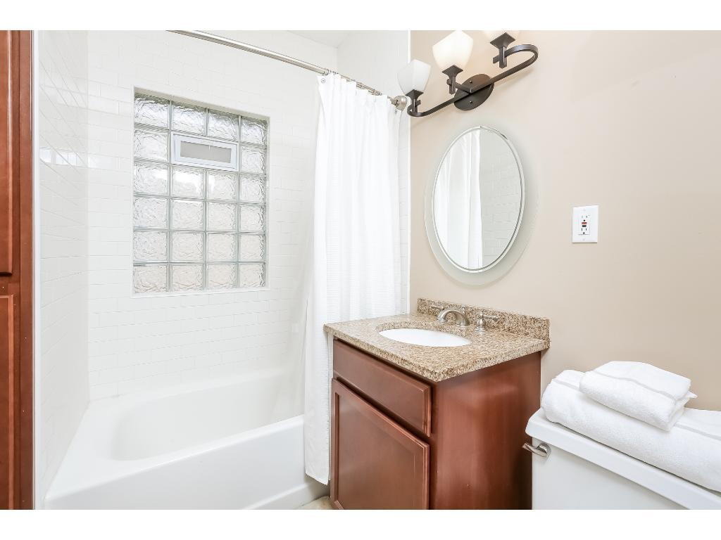 Updated bathroom on main floor has state-of-the-art showerhead