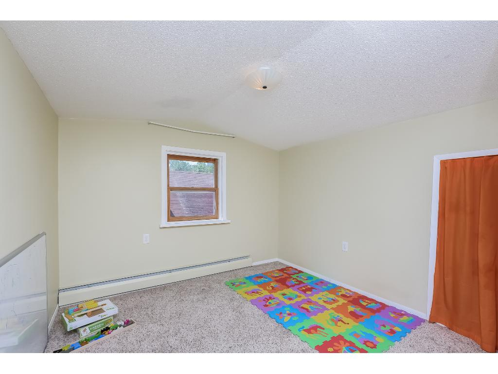 Upper level has two bedrooms and a large play area.  This is one of the bedrooms.