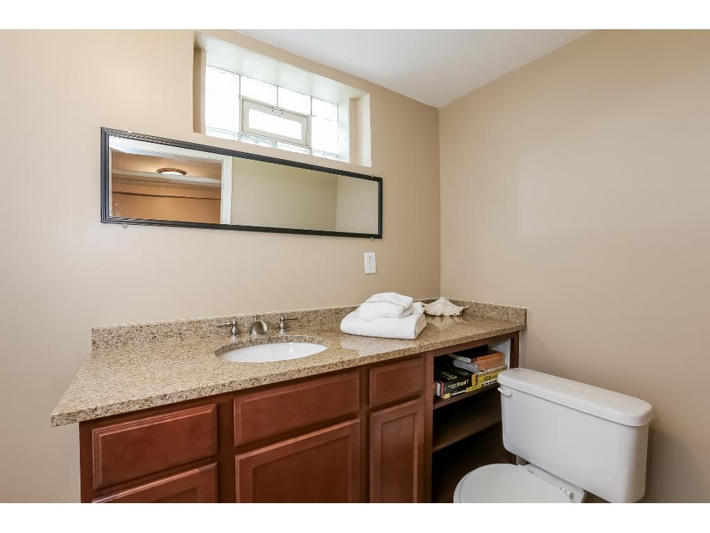 Full bathroom in the basement is spacious and includes a separate dressing area.