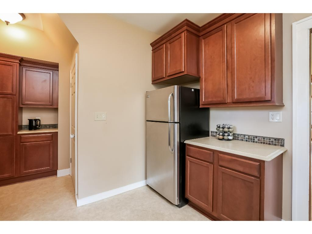 Coffee bar on the far wall; stainless appliances