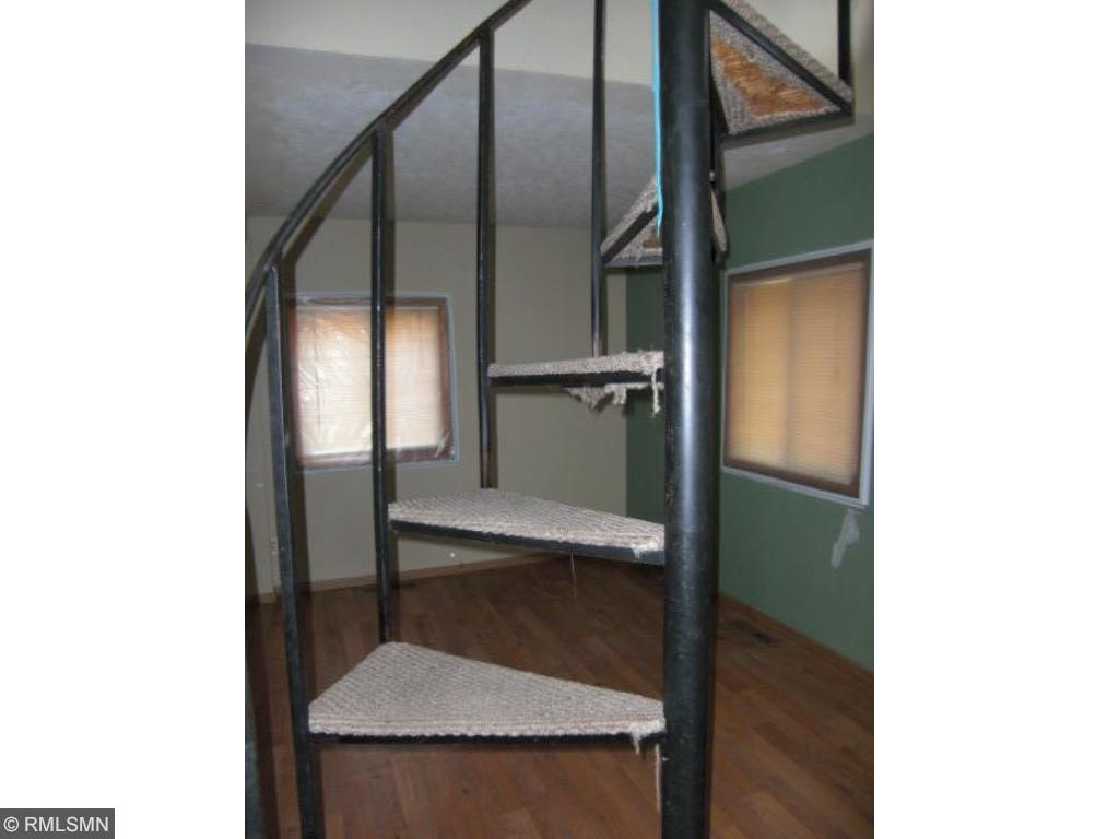 spiral staircase to the lot/ bedroom