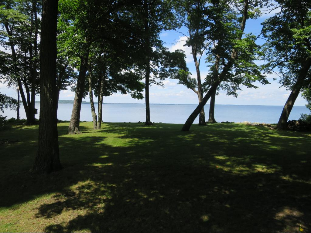 THIS IS YOUR NEW LAKESHORE PROPERTY WITH 142' OF LEVEL LAKE ACCESS, PARKLIKE GROUNDS, AND SPECTACULAR VIEWS TO THE NORTH.
