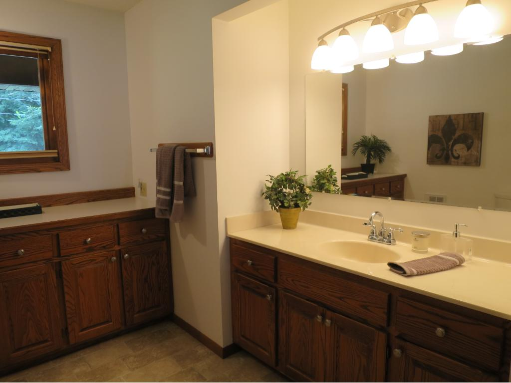 THIS IS THE GENEROUS SIZED MAIN FLOOR BATH, THAT ENJOYS LOTS OF NATURAL LIGHT, AND AN ABUNDANCE OF STORAGE SPACE.  THIS BATH HAS A WALK-THRU TO THE MASTER BEDROOM.