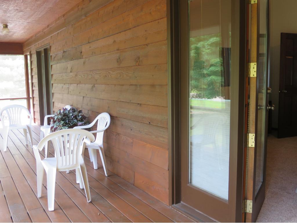 THIS IS THE SCREEN PORCH, WITH ACCESS FROM THE MASTER BEDROOM.  YOU'LL LOVE BEING ABLE TO ENJOY SUMMER BREEZES AS YOU DRIFT OFF TO SLEEP.........