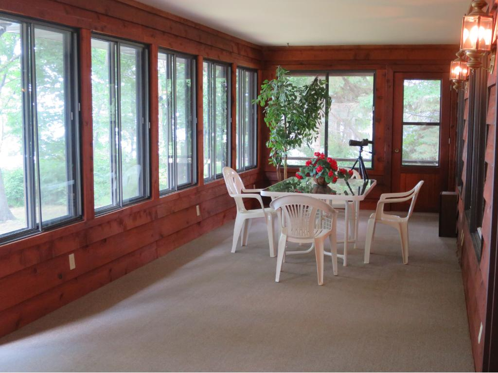 THIS IS THE VIEW OF THE DINING AREA OF THE THREE-SEASON PORCH, LOOKING TO THE NORTH-EAST.