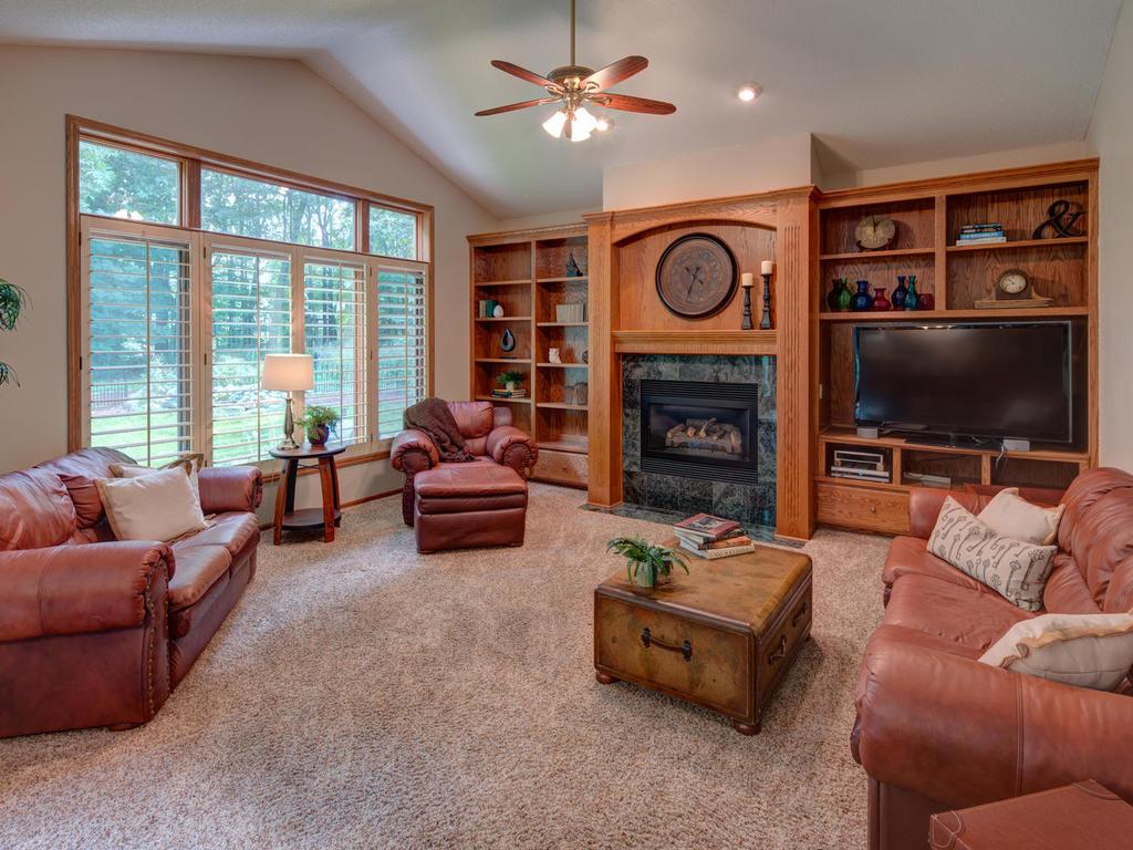 Beautiful built-ins surround your fireplace in vaulted family room overlooking treed backyard.