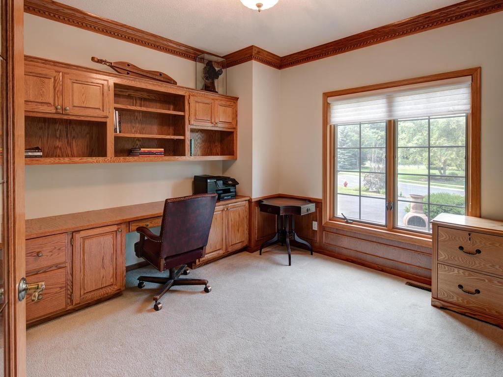 Main floor office, with many built-ins,  provides space to work or study.