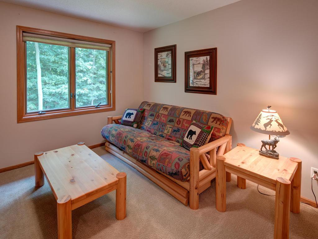 One of the three junior bedrooms upstairs - overlooks the backyard.